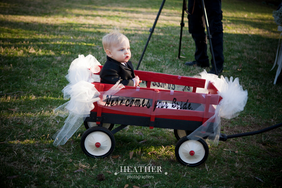 here comes your bride wagon ring bearer Heather Photographers