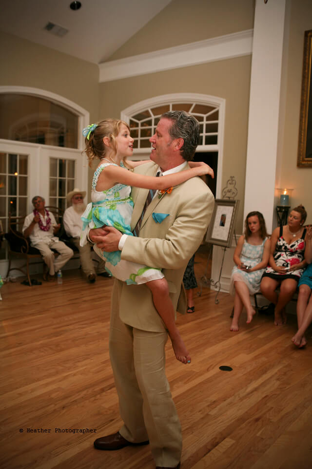 Daddy & his littlest girl dance and sing together.