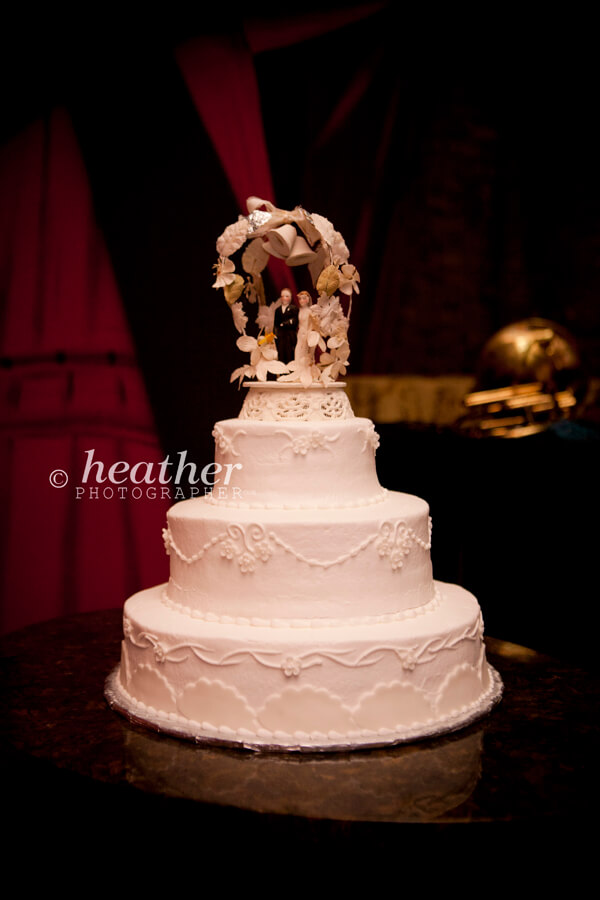 bride's cake with vintage cake topper